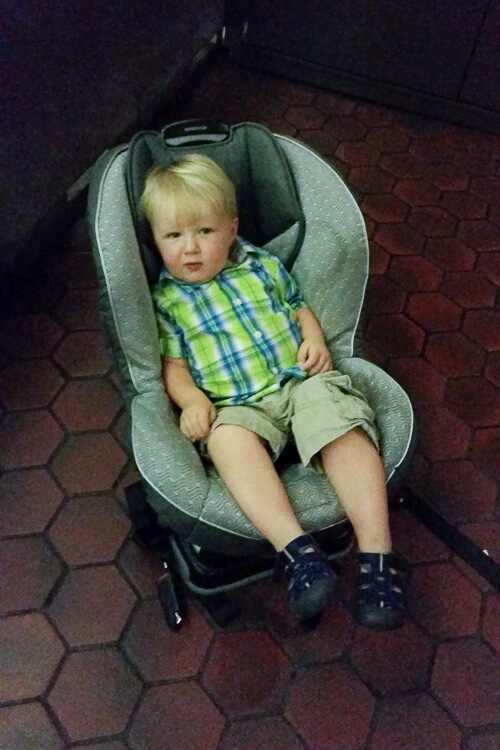 Matthew waiting in car seat to go to the airport
