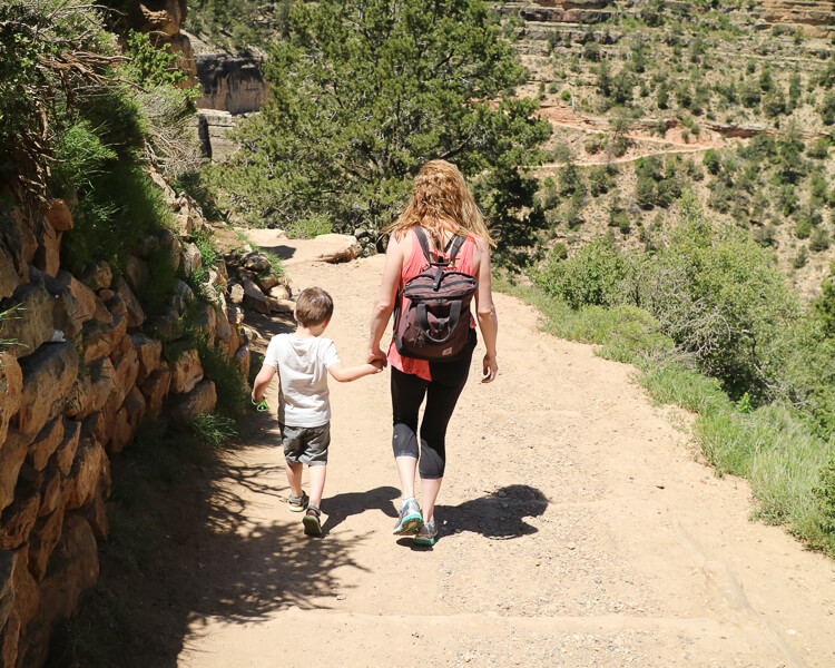 Mom on son hiking Bright Angel Trail at the Grand Canyon