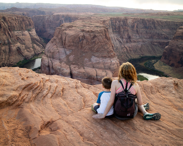 Mother and Son looking out over Horseshoe Bend in Page, Arizona